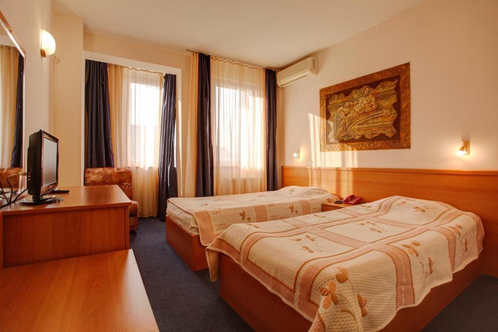 Giường trong phòng chung tại Hotel Rocentro