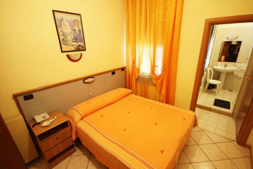 Cama ou camas em um quarto em Hotel Casanova