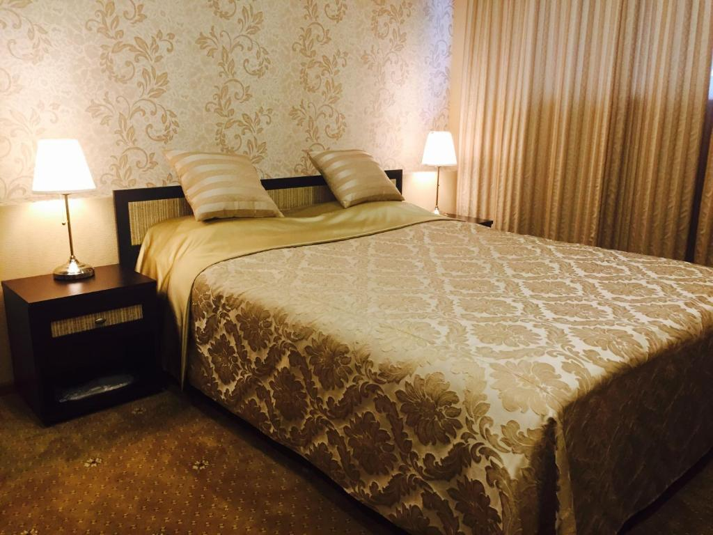 A bed or beds in a room at Mini-hotel Barskiy