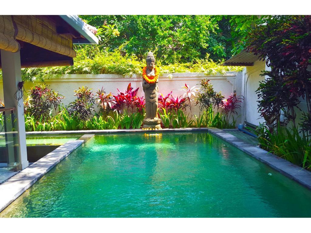 The swimming pool at or near Juada Garden