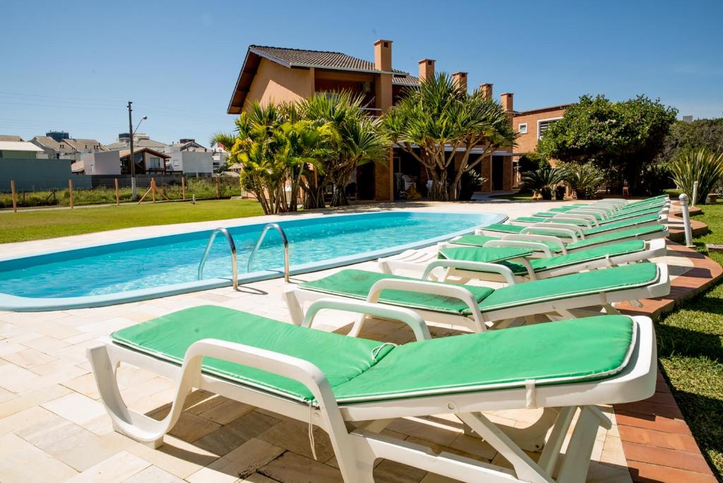 The swimming pool at or near Costa Allegra Ingleses Residence