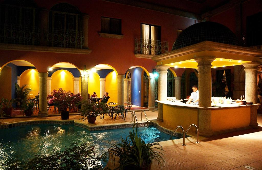 The swimming pool at or near Hotel Portal del Angel
