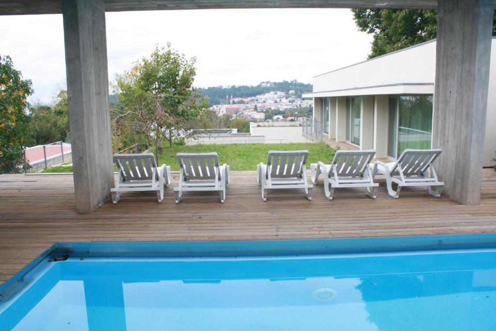 The swimming pool at or near Casa do Castanheiro