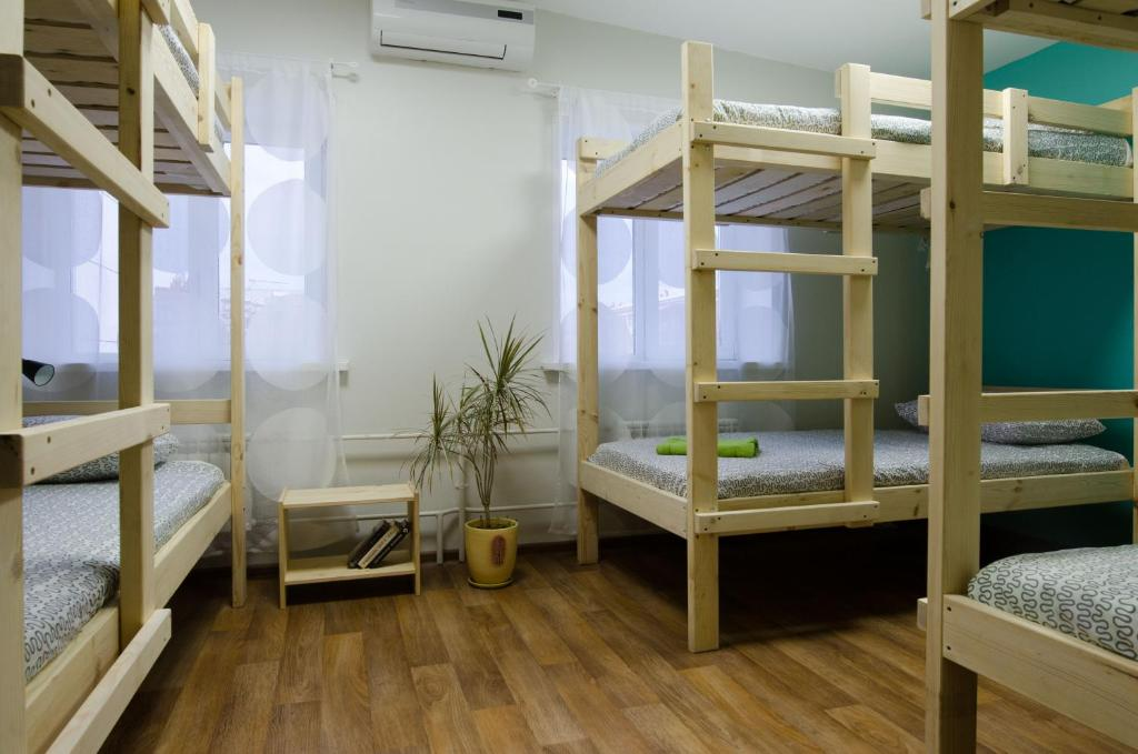 A bunk bed or bunk beds in a room at Hostel Vozduh