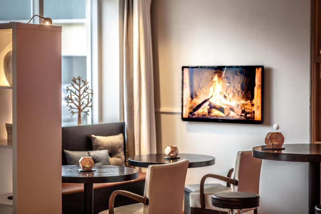 TV o dispositivi per l'intrattenimento presso Hotel Nordurland by Keahotels