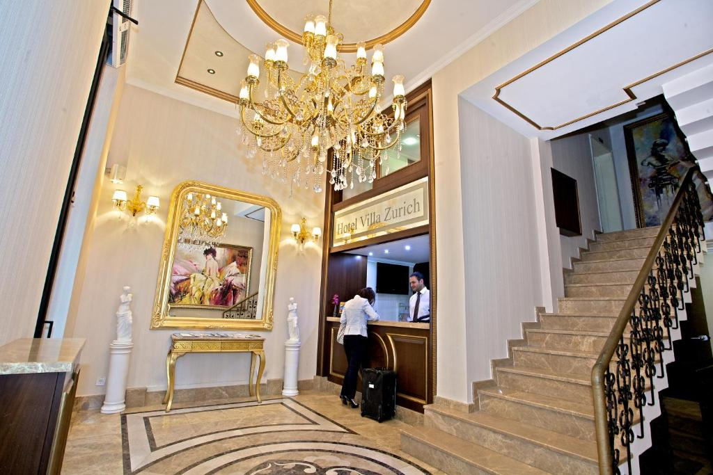 The lobby or reception area at Hotel Villa Zurich