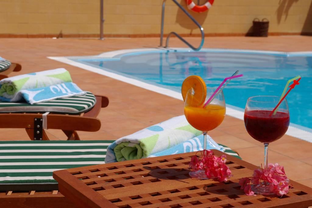 The swimming pool at or near Hotel Rural El Navío - Adults Only