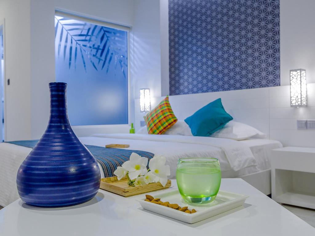 A bed or beds in a room at Velana Beach Maldives