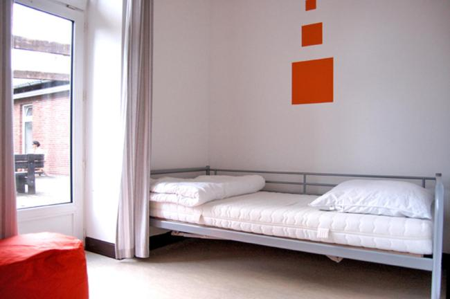 A bed or beds in a room at Hostel Flensburg