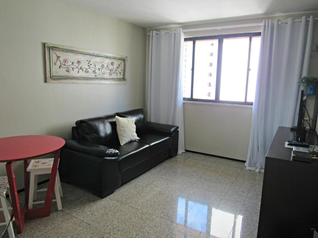 A seating area at Residencial em Meireles