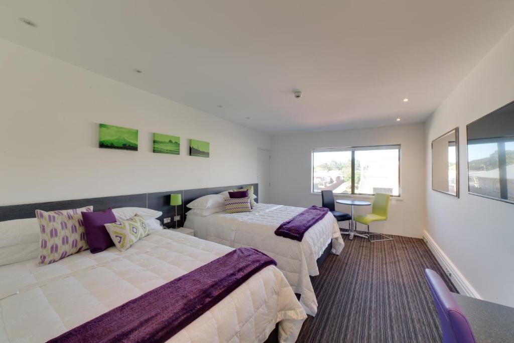 Ліжко або ліжка в номері The Devon Hotel A Heritage Hotel