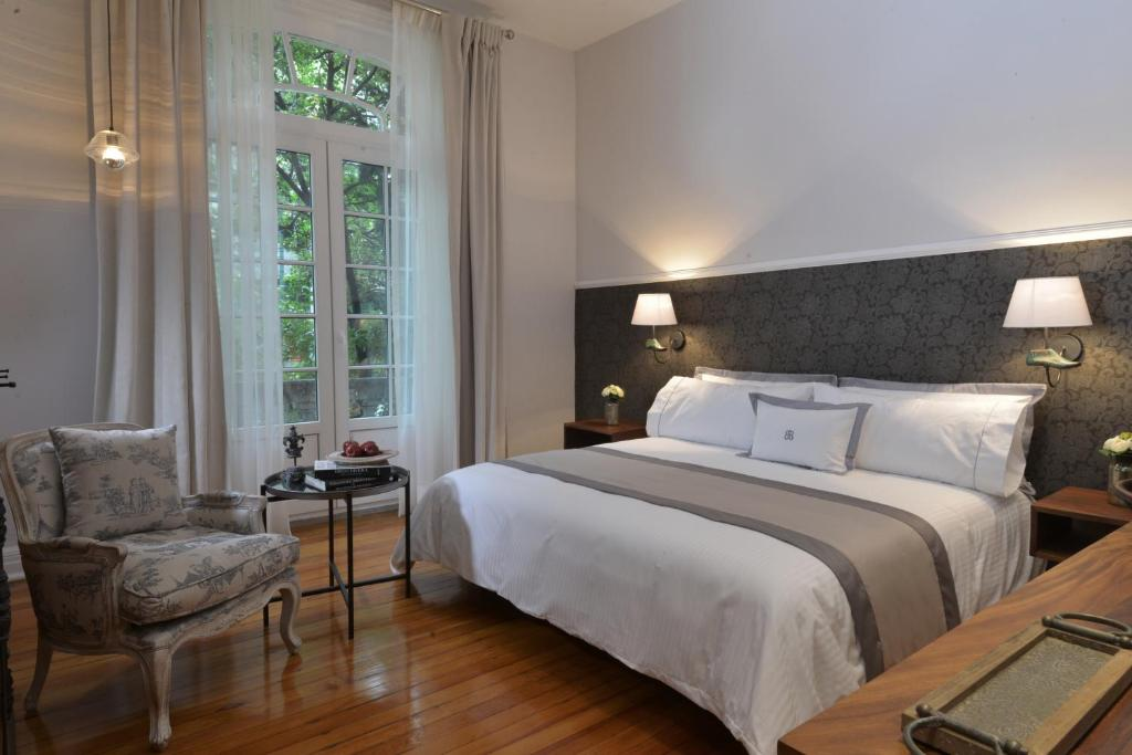 A bed or beds in a room at Casa Goliana La Roma