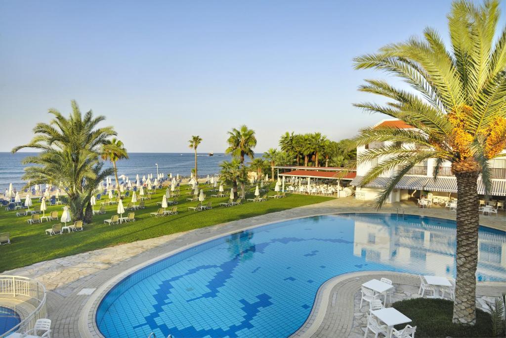 The swimming pool at or near Akti Beach Hotel & Village Resort
