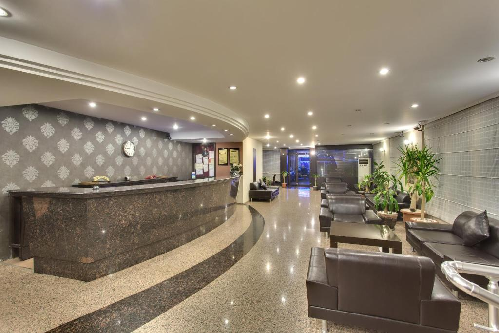 The lobby or reception area at Antroyal Hotel