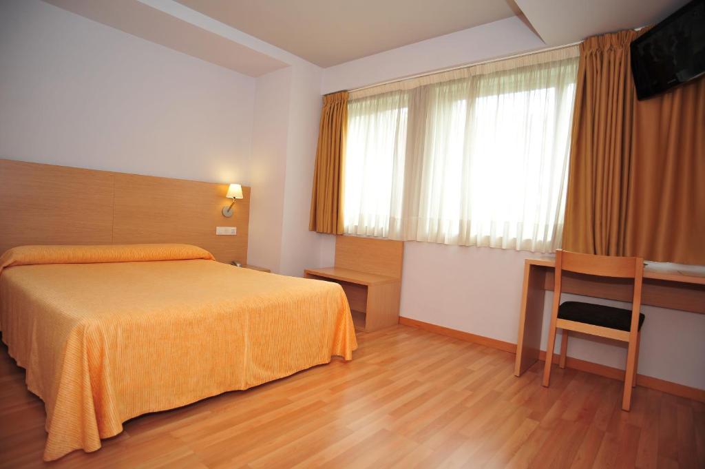Krevet ili kreveti u jedinici u okviru objekta Hotel Windsor