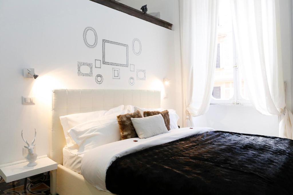 Cama o camas de una habitación en Genova Guest House