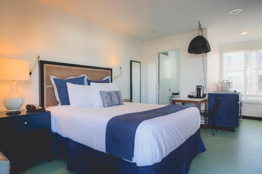 A bed or beds in a room at Mylo Hotel