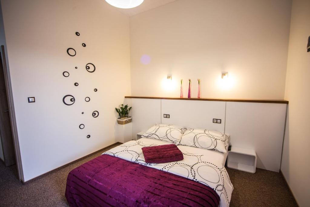 Postel nebo postele na pokoji v ubytování Penzión Gemin