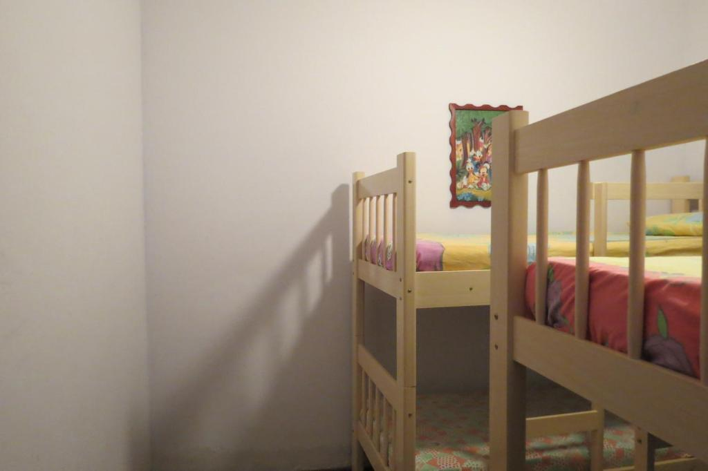 A bunk bed or bunk beds in a room at Casa da Fran
