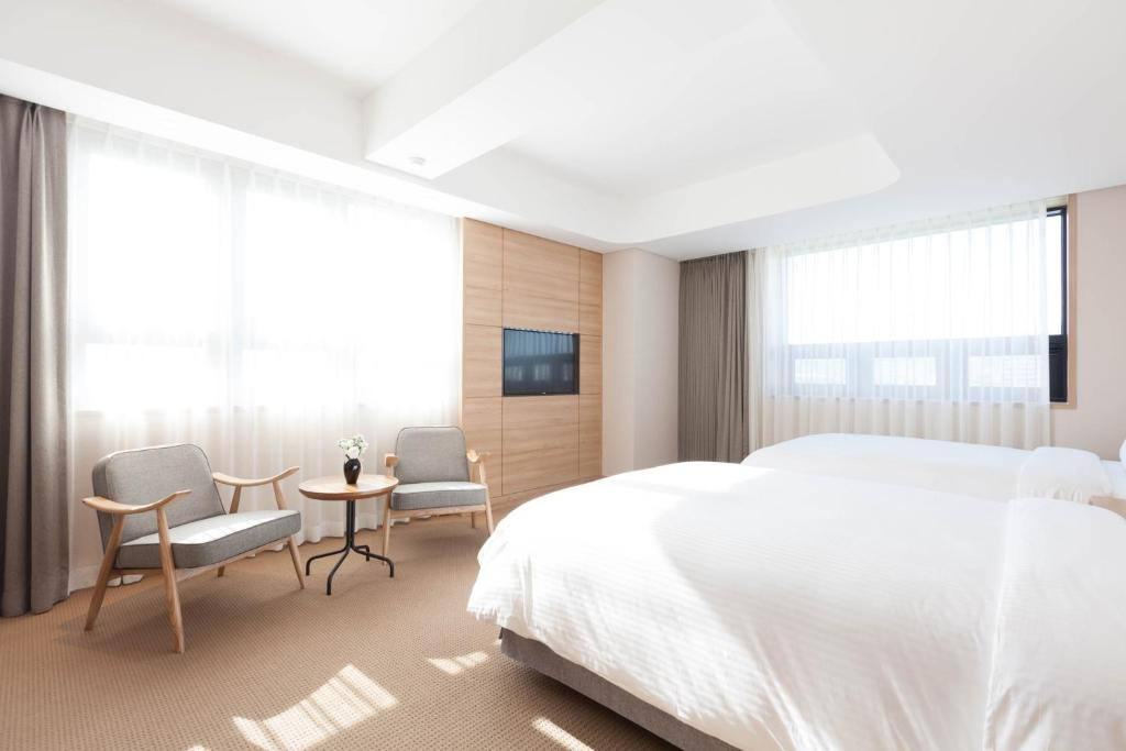 A bed or beds in a room at Acube Hotel Dongdaemun