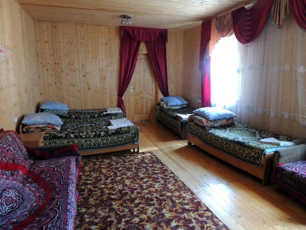 A bed or beds in a room at Lesnaya Skazka Hotel