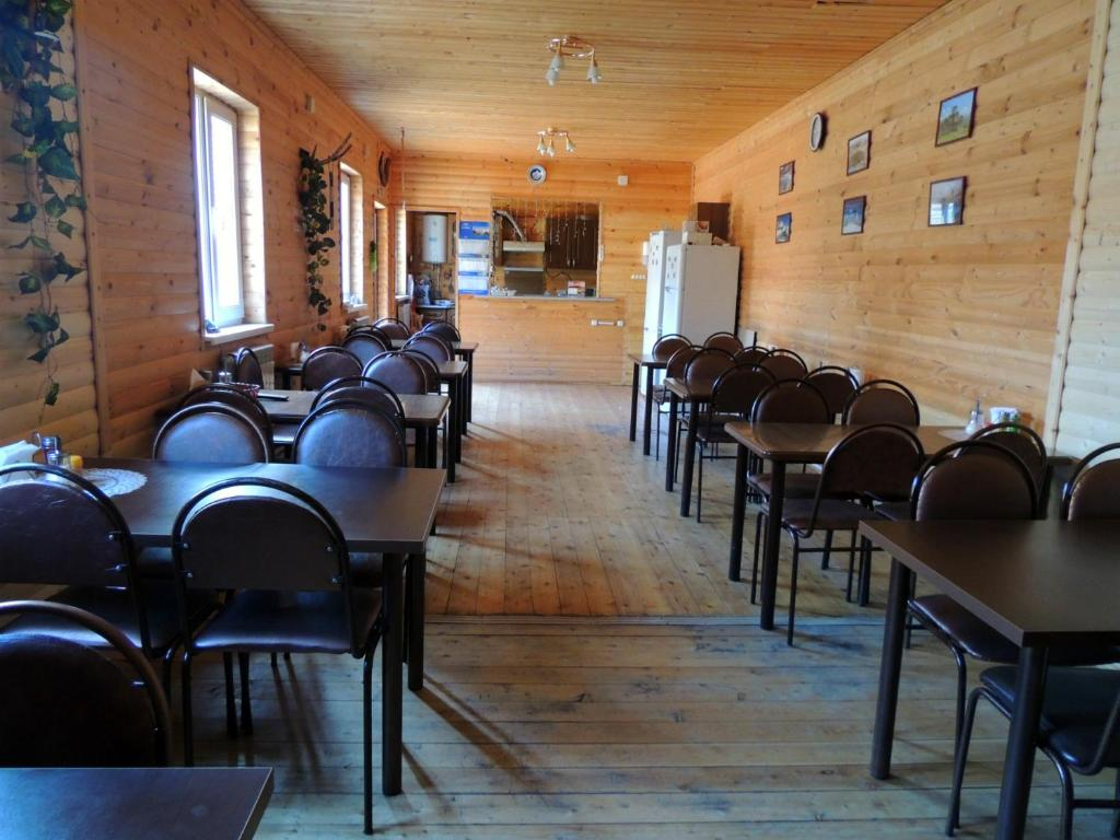 A restaurant or other place to eat at Lesnaya Skazka Hotel