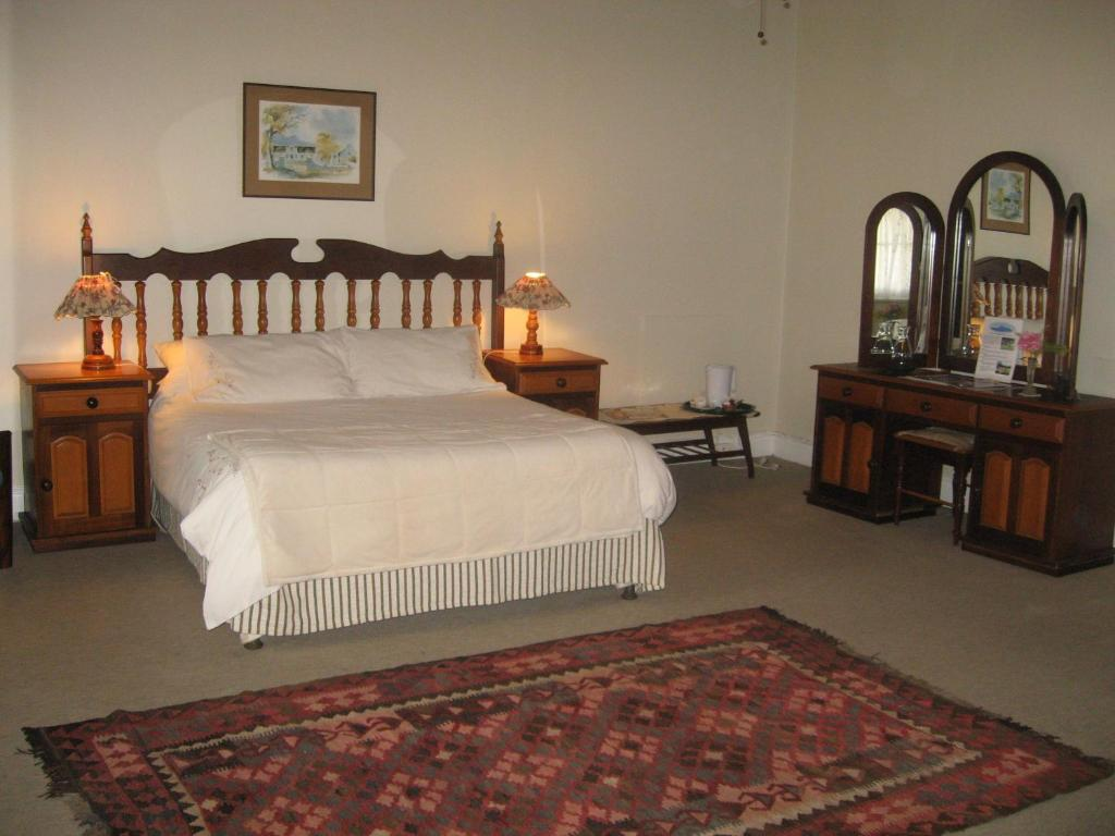 A bed or beds in a room at Sleeping Beauty Guesthouse