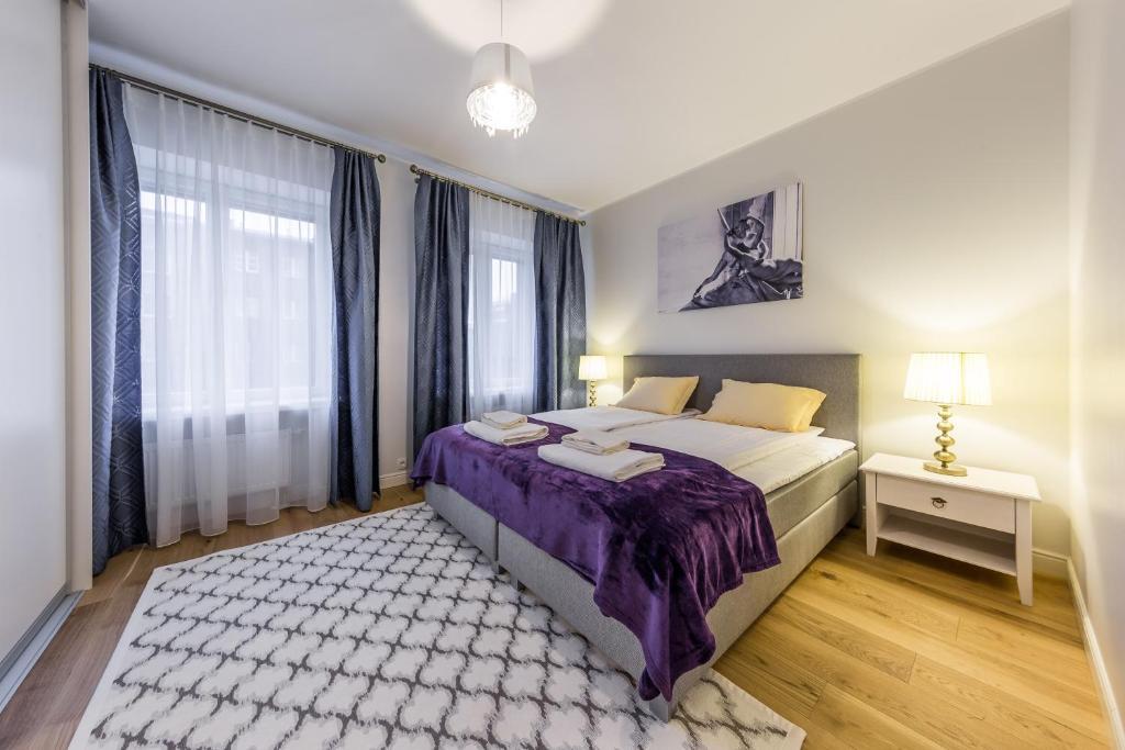Vuode tai vuoteita majoituspaikassa Pronksi 3 Apartments