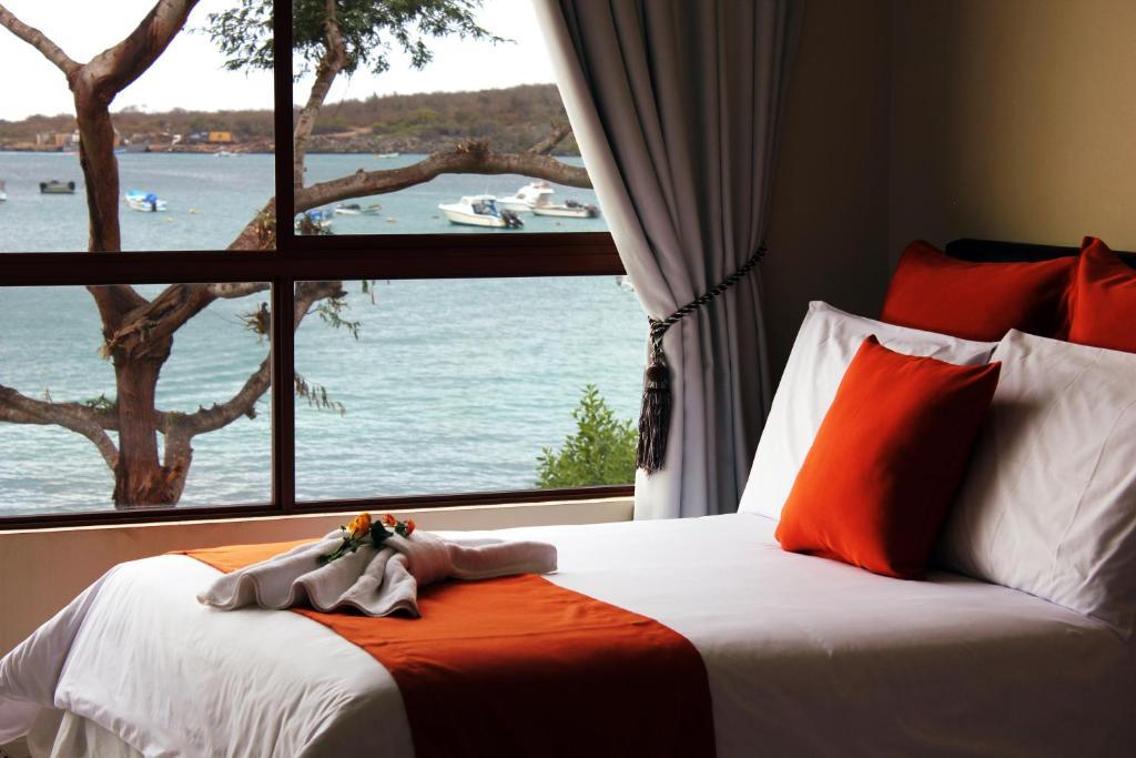 A bed or beds in a room at La Zayapa