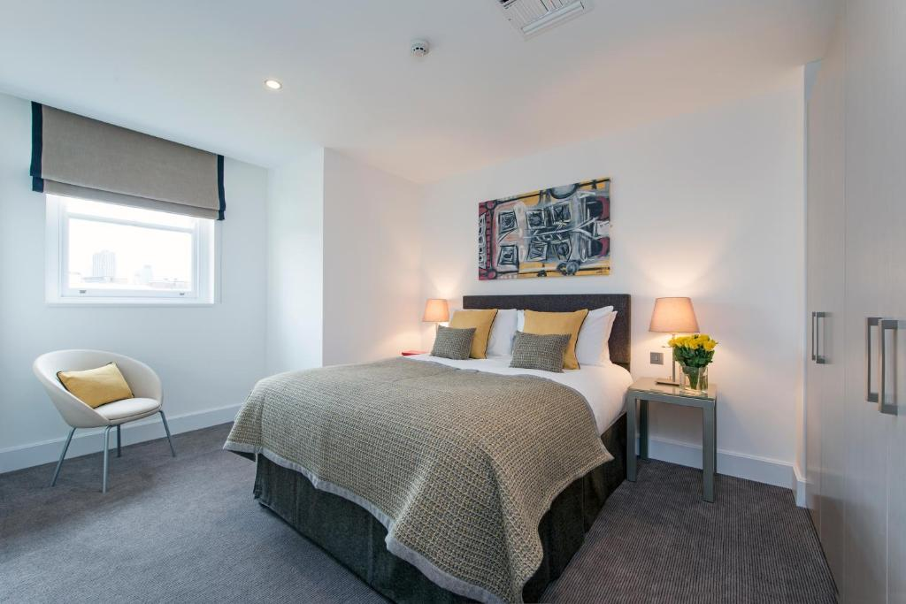 A bed or beds in a room at The Rosebery Aparthotel