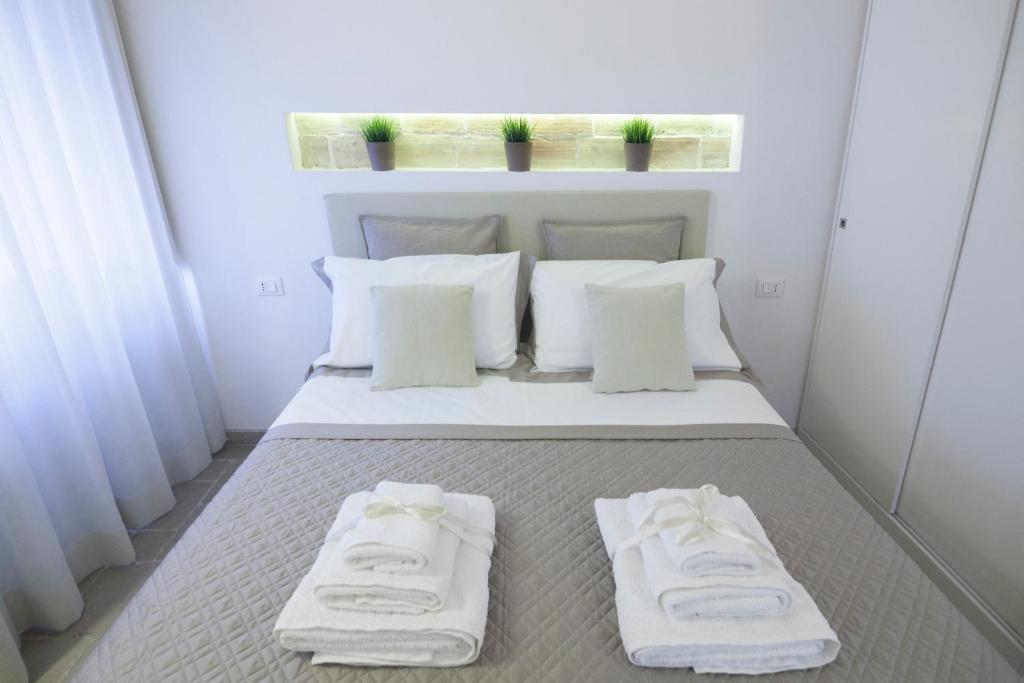 Ein Bett oder Betten in einem Zimmer der Unterkunft Numero 85