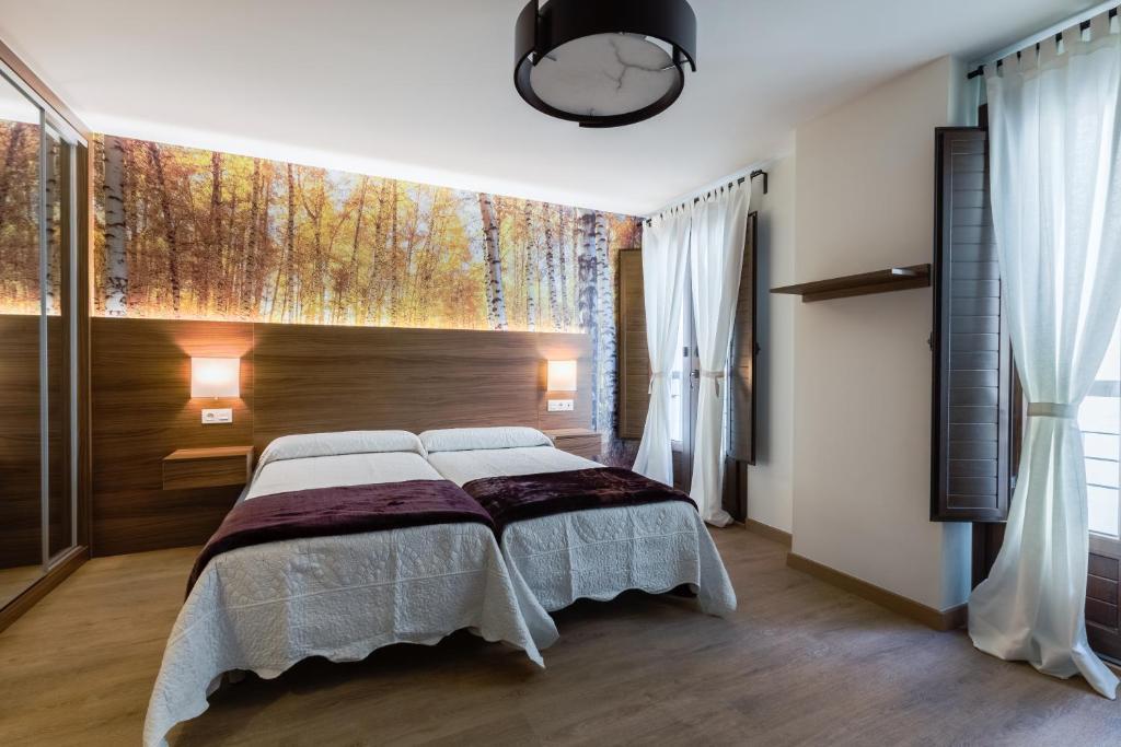 Cama o camas de una habitación en H. Residencia Arriola