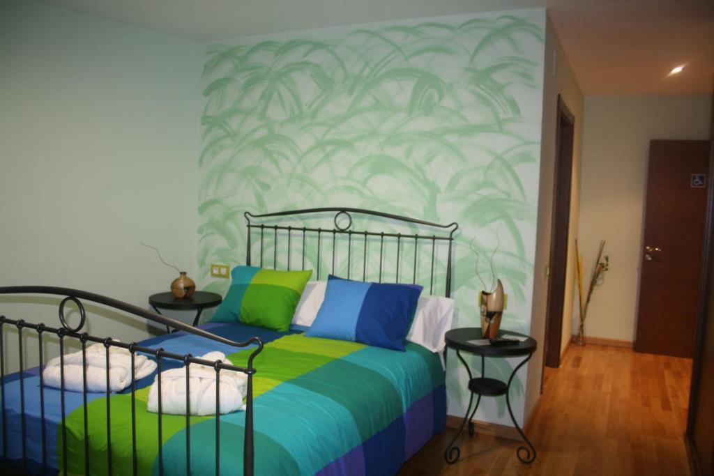 Кровать или кровати в номере Casa Felisa Marcelle