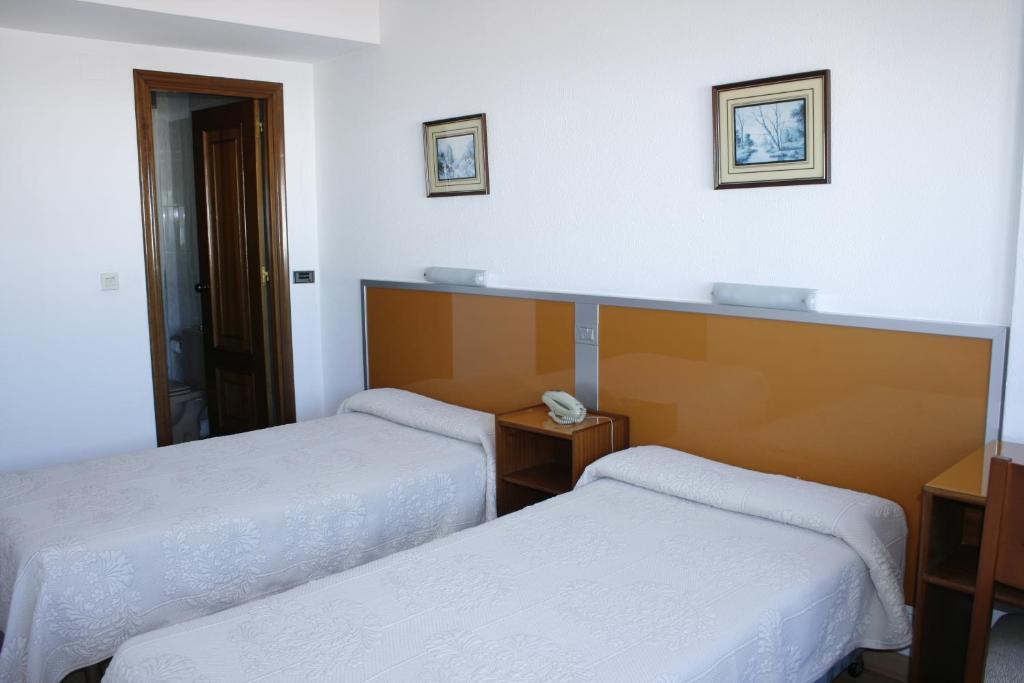 Cama o camas de una habitación en Hostal Liste Station