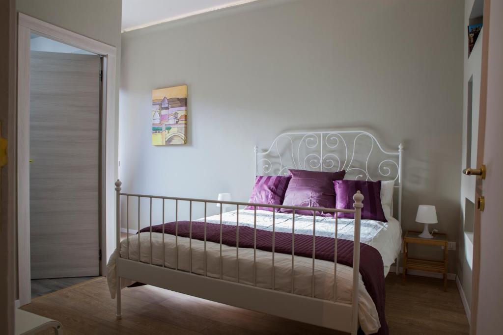 Letto o letti in una camera di Un Attimo A Roma B&B