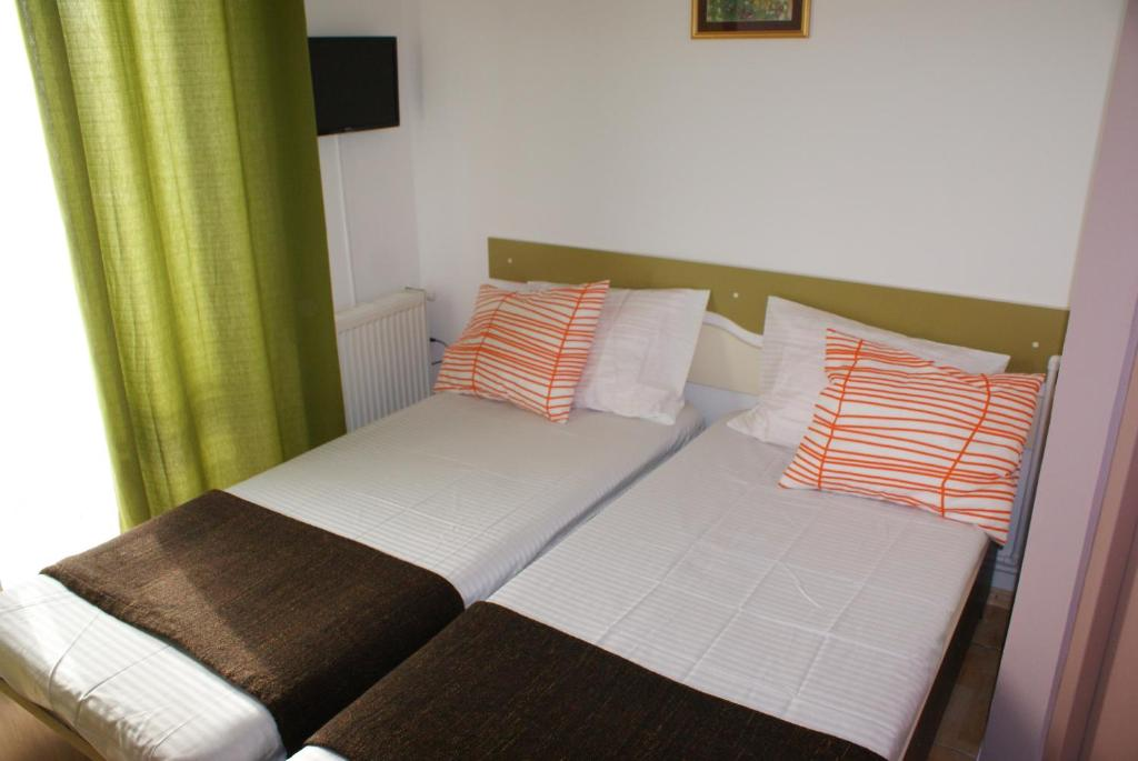 A bed or beds in a room at Villa Siret