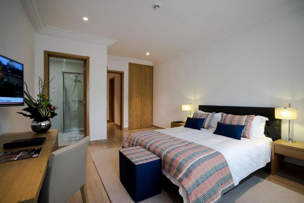 Un ou plusieurs lits dans un hébergement de l'établissement Fiesta Residences Boutique Hotel and Serviced Apartments.