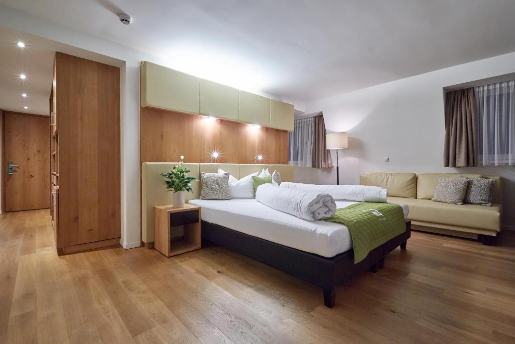 Ein Bett oder Betten in einem Zimmer der Unterkunft m3Hotel