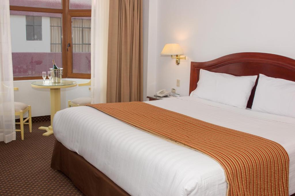 Un ou plusieurs lits dans un hébergement de l'établissement Hotel Hacienda Puno