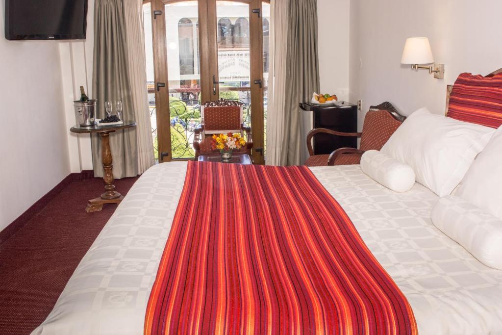 Un ou plusieurs lits dans un hébergement de l'établissement Hotel Hacienda Plaza de Armas