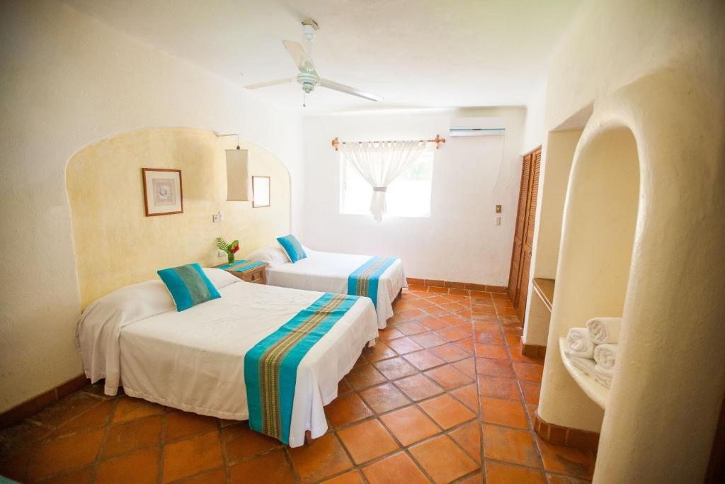 A bed or beds in a room at Hotel Villas Sayulita