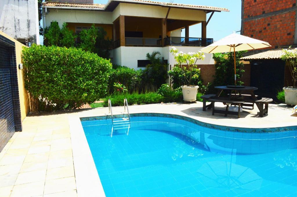 The swimming pool at or near Casa Atalaia