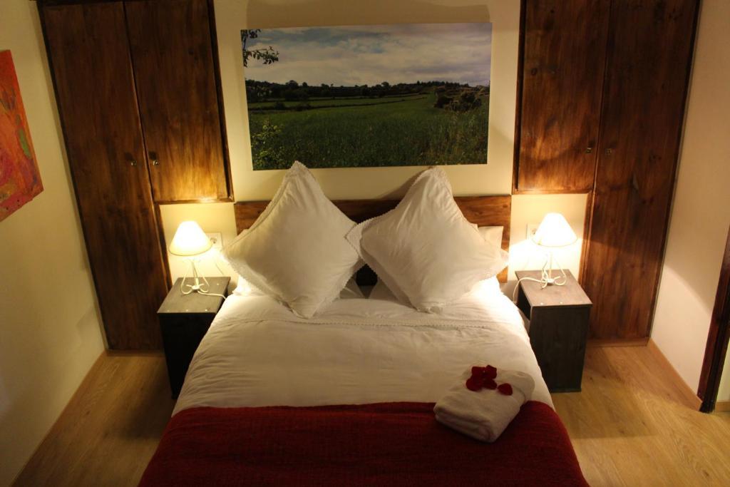 Cama o camas de una habitación en Casa Rural Las Dalias con Hidromasaje