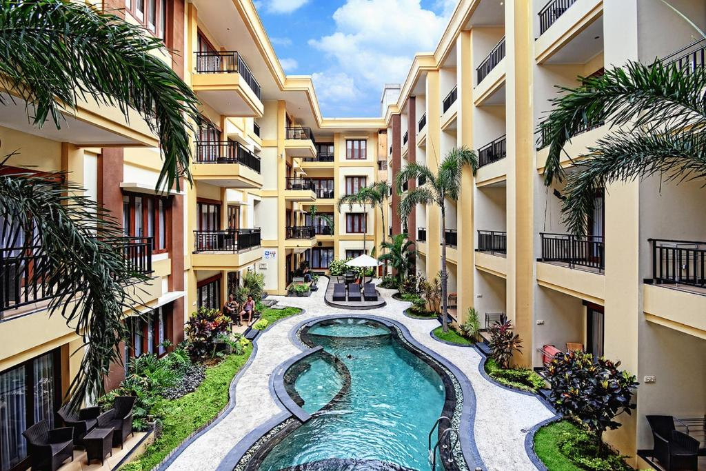 The swimming pool at or close to Kuta Town House Apartments
