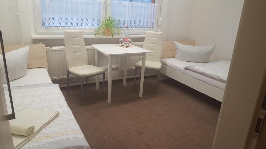 Ein Sitzbereich in der Unterkunft Gästepension - Elsterland am Sport- und Freizeitpark