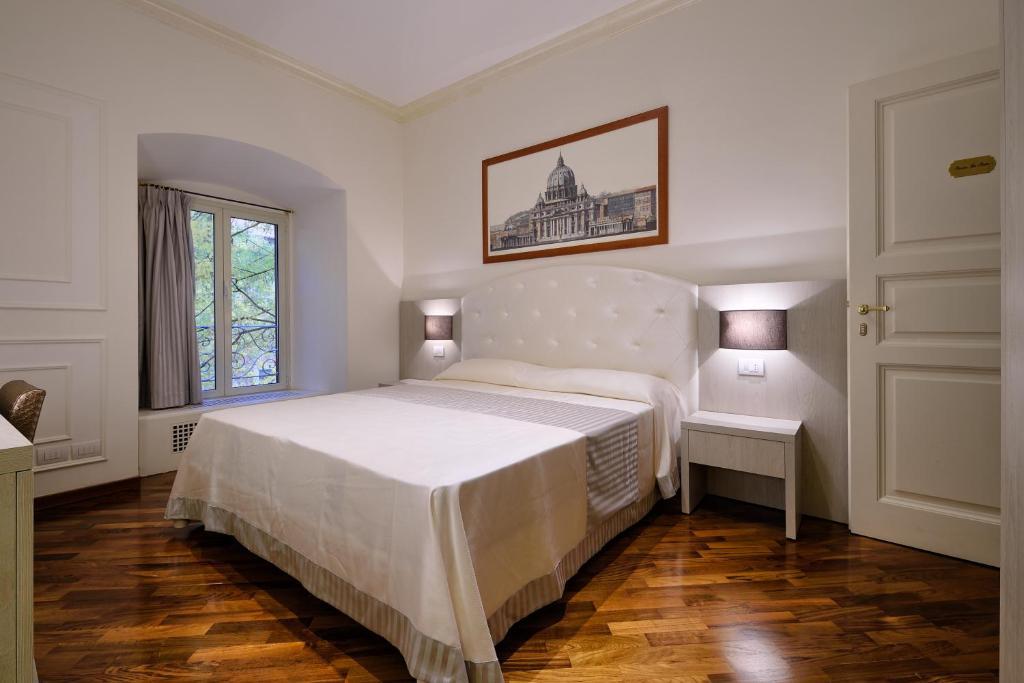Een bed of bedden in een kamer bij Lory House