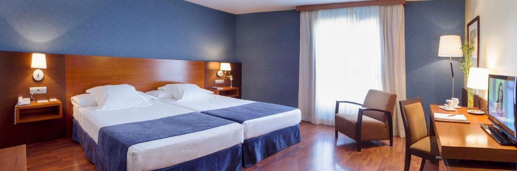 En eller flere senger på et rom på Hotel Torre de Sila