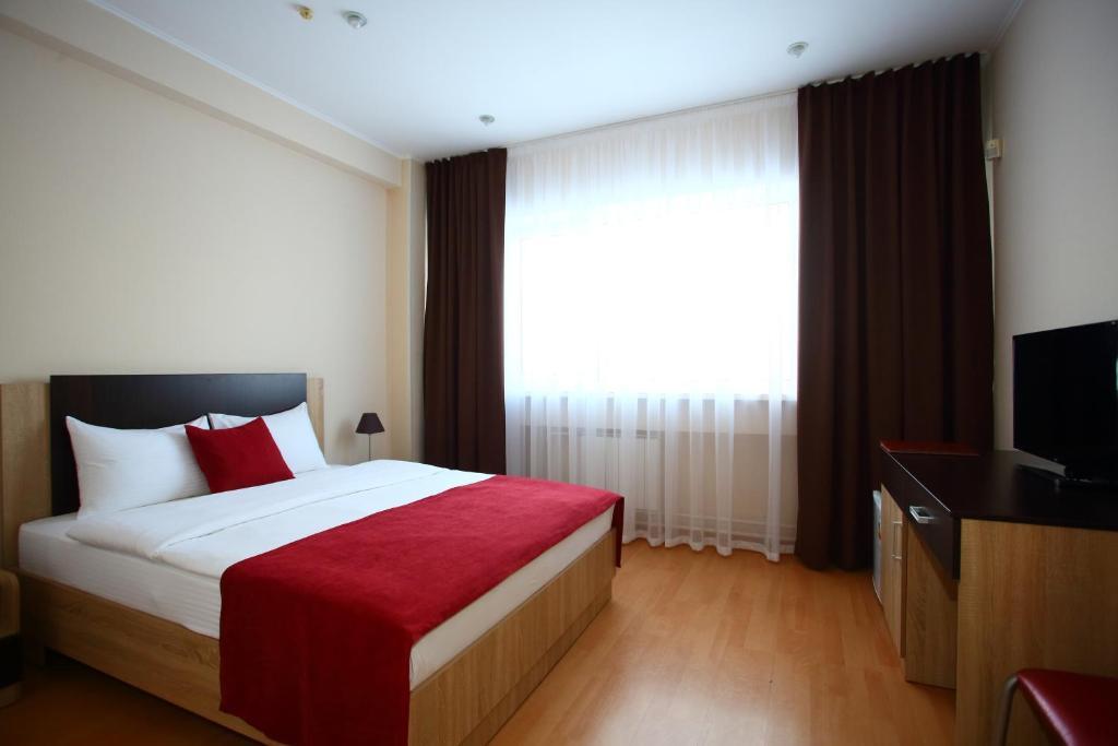 Кровать или кровати в номере Максим Отель