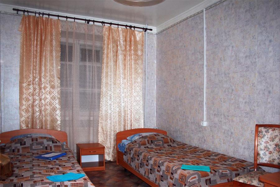 A bed or beds in a room at Lesogorskaya estate RUUSYAVI