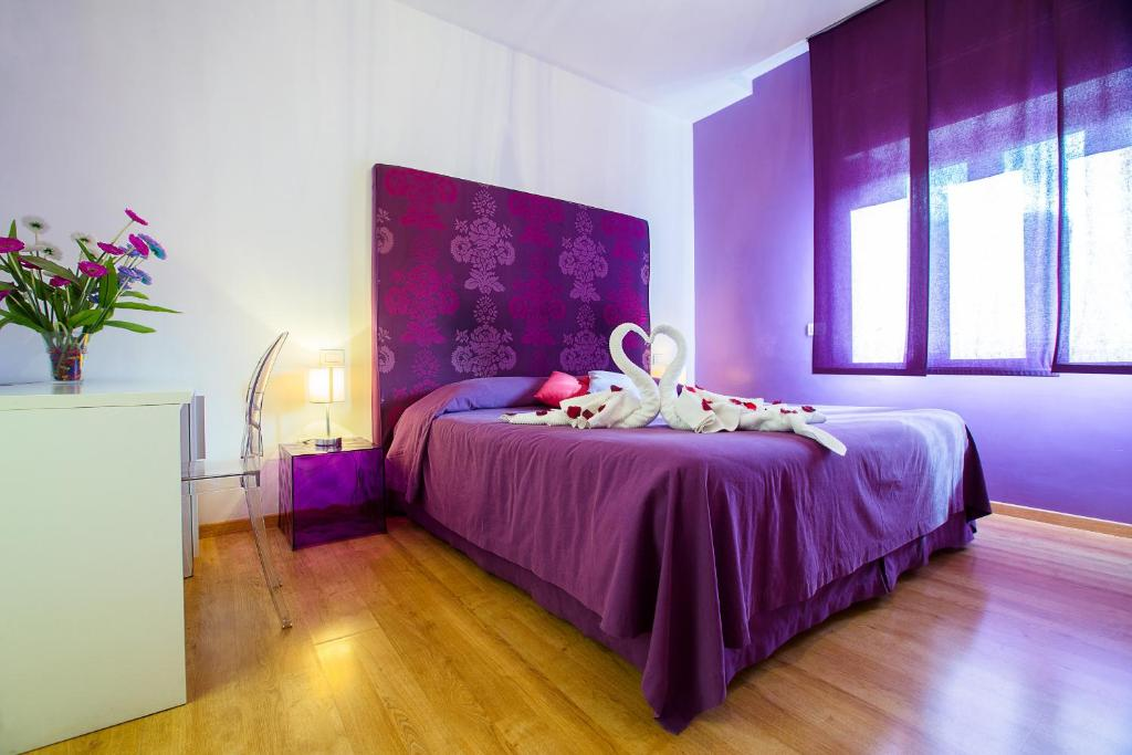 A bed or beds in a room at Emily Suites Sorrento